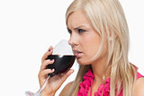 Blonde drinking a glass of wine