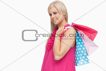 Smiling blonde holding shopping bags
