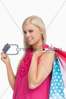 Blonde holding shopping bags and a card