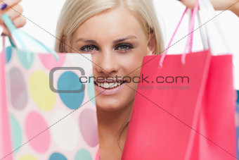 Smiling blonde showing her shopping bags