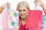 Beautiful blonde showing shopping bags