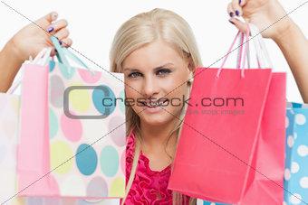 Beautiful blonde showing shopping bags
