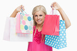 Happy blonde showing shopping bags
