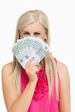 Blonde in pink holding 100 euros banknotes
