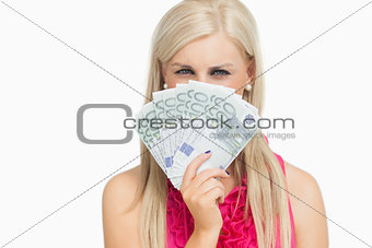 Beauty holding 100 euros banknotes