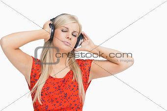 Blonde in orange dress enjoying music