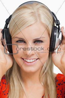 Smiling blonde listening to music