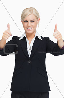 Smiling blond businesswoman thumbs-up