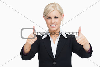 Smiling blonde businesswoman thumbs-up