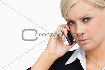 Attractive businesswoman using her mobile