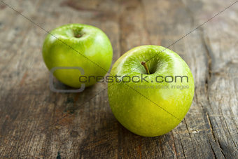 Green apples on wood table
