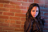 Pretty Mixed Race Young Adult Woman Against a Brick Wall