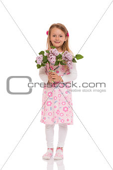 Smiling little girl with lilac flowers