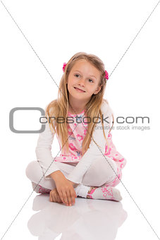 Portrait of a little girl sitting