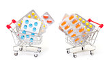Multicolored pills packs in shopping cart