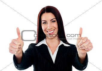 Confident businesswoman showing double thumbs-up