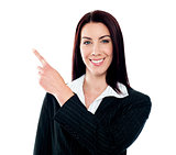 Business lady pointing at copyspace