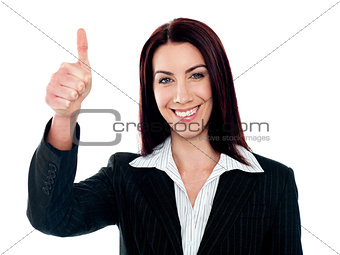 Glamorous corporate lady gesturing thumbs-up