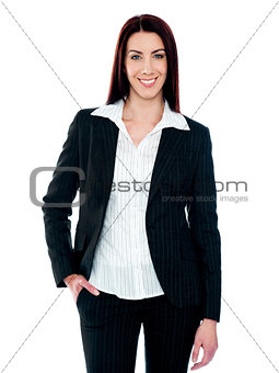 Stylish businesswoman posing with hand in pocket