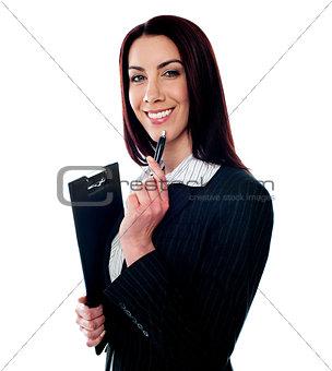 Female executive holding a clipboard
