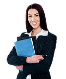 Portrait of smart smiling secretary holding file