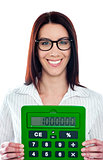 Smiling corporate lady showing green calculator