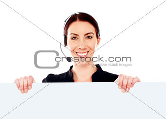 Attractive help-desk female holding blank placard