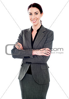 Corporate lady standing with her arms crossed