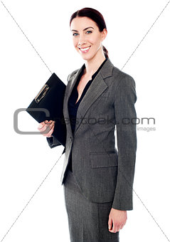 Corporate woman posing with clipboard