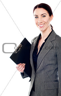Smiling female secretary holding clipboard