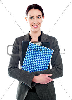 Corporate lady posing with clipboard and notepad