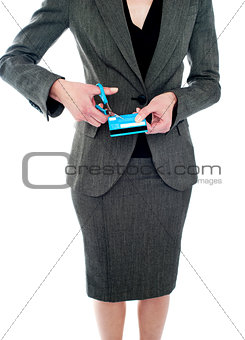 Cropped image of woman destroying credit card