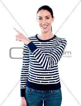 Woman pointing index finger at something