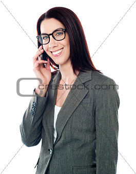 Smiling female executive talking on mobile