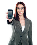 Saleswoman displaying latest mobile handset