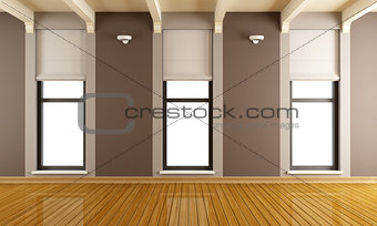 Brown empty room with three windows