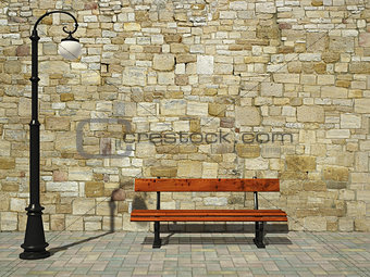 Brick wall with street light and bench