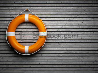 Lifebuoy attached to a wooden wall