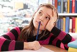 Schoolchild thinking while doing homework