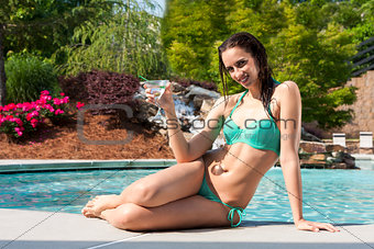 Happy woman at swimming pool