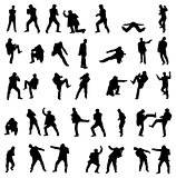 Silhouettes of the fighting men - vector set.