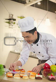 asian chinese chef preparing foods for his customer with kitchen