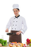 good looking asian chinese chef preparing foods for his custome