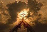 dramatic cross on a church with cloudy gloomy mood
