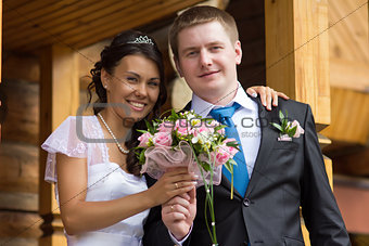 The bride and groom with a bouquet