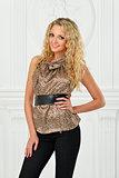 Beautiful blonde in leopard print blouse.