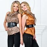 Two beautiful women in elegant evening suit.