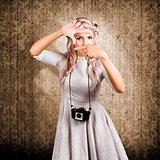 Grunge girl with retro film camera concept framing