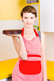 Woman in Red Apron with Chocolate Cake
