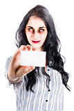 Scary female zombie handing over business card